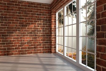 Bakstenen kamer met een groot raam in een bos Stockfoto