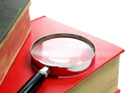 Magnification glass and books background photo