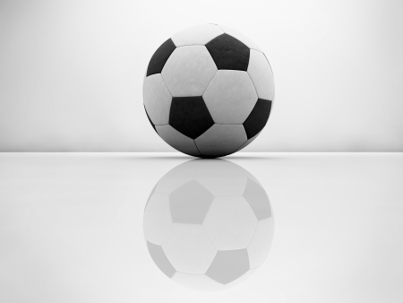 Football black and white on glossy surface photo