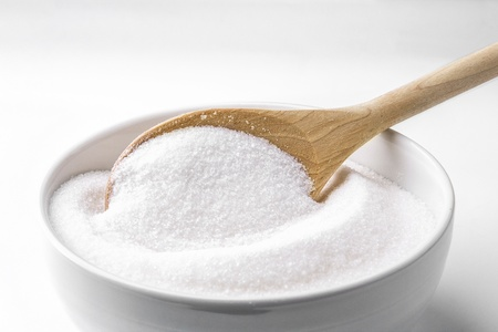 Wooden spoon and white sugar