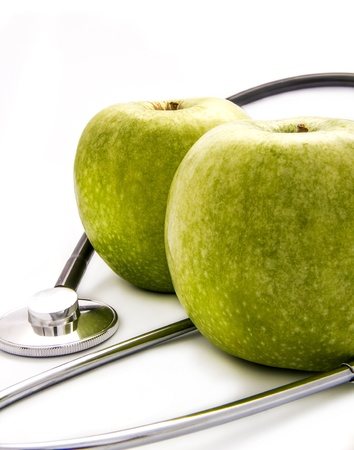 Two apples and stethoscope Imagens