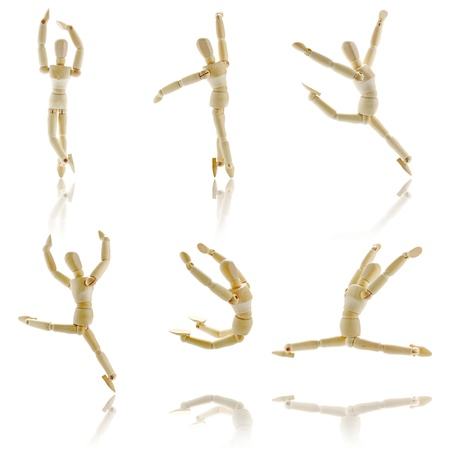 marioneta de madera: Figuras de madera en que presenta en blanco Foto de archivo