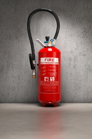 fire extinguisher: Fire extinguisher on concrete wall