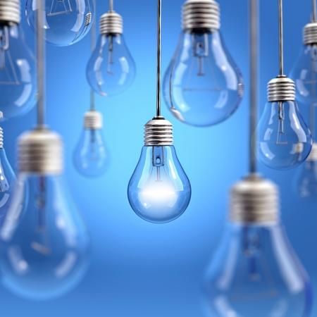 Light bulbs hanging on blue background