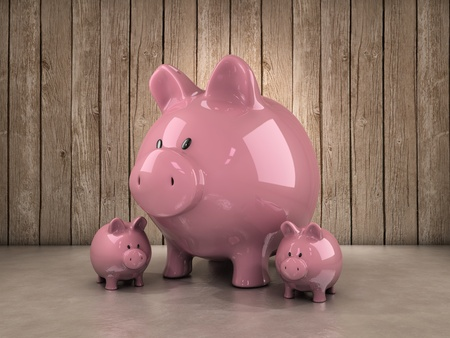 side table: Three piggy bank, one large and two smaller ones Stock Photo