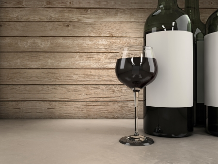 wine growing: Wine glass and bottles background Stock Photo