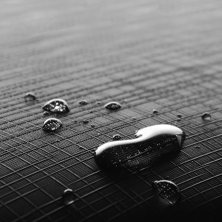 wetness: few drops on a checkered fabric