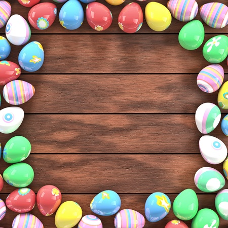 Colorful Easter eggs on a table forming a frame photo