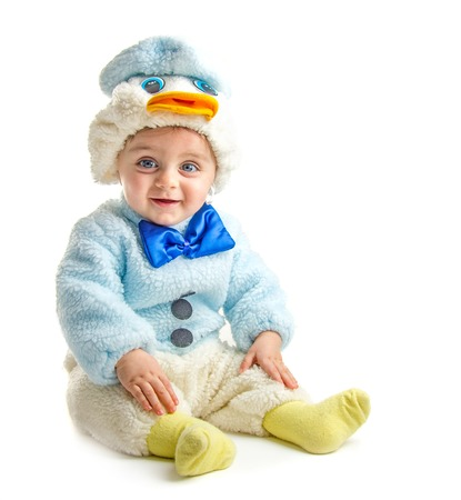Baby in duck suit posing at camera on white background photo
