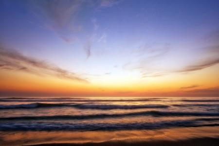 後半午後夕陽が美しいビーチ 写真素材
