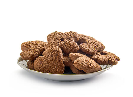 Several chocolate cookies over white dish photo