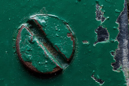 oxidized: Background of a green painted rusty screw