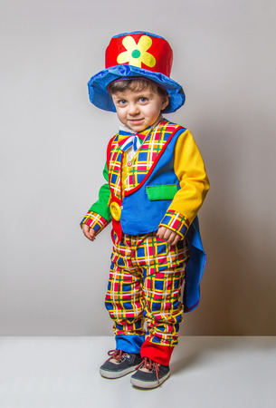 Funny Child wearing a clown suit photo