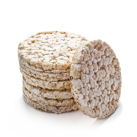 Pile of rice crackers on wite background