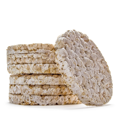 low light: Pile of rice crackers on wite background