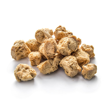 Pile of soy nuggets on white background