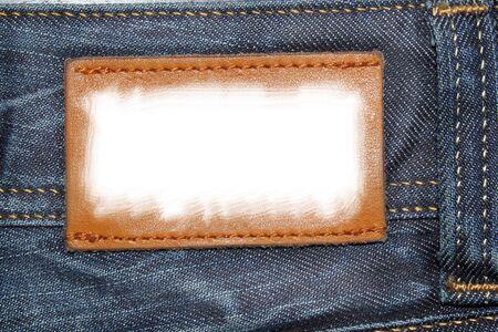Lable blanco en una tela de jeans Foto de archivo - 75501127