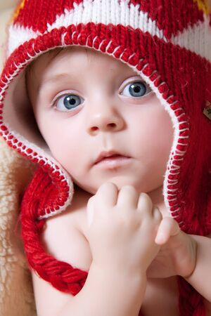 Cute baby wearing red bonnet Stock Photo