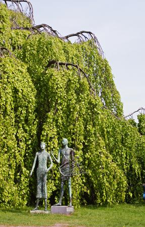 adam and eve: Adam and Eve under a beech-Hamburg-Germany Stock Photo