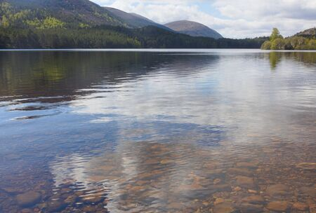 Loch an Eilein is an extremely beautiful sheet of water, reflecting the magnificent pines of Rothiemurchus Forest in which it lies. This photo shows the magnificent landscape.