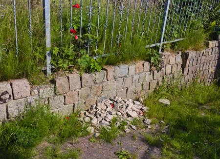 Nothing has been done on this wall at a garage entrance in northern Germany for a long time - it is beginning to crumble