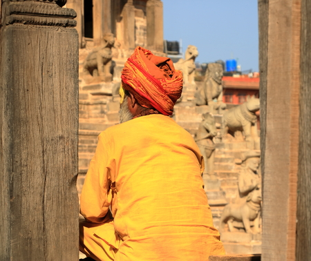 Portrait of sadhu with orange clothes in Nepal Stock Photo