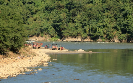 A Group of Worker busy working In a sand mine next to the river. Stock Photo