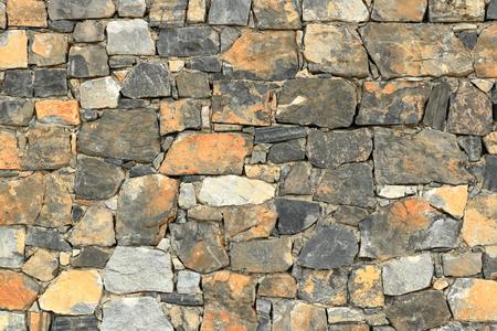 Big gray wall made from stone bricks Stock Photo