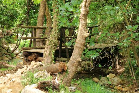 Closeup of deformed and dilapidated wooden bridge on Crete in Greece Imagens