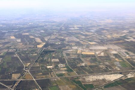 Panoramic view of green fields near the desert, Uzbekistan