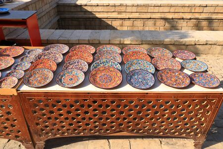 Decorative ceramic plates with traditional uzbekistan ornament on street market in Central Asia, Silk Road Stock Photo