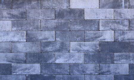 Big gray wall made from stone bricks 写真素材