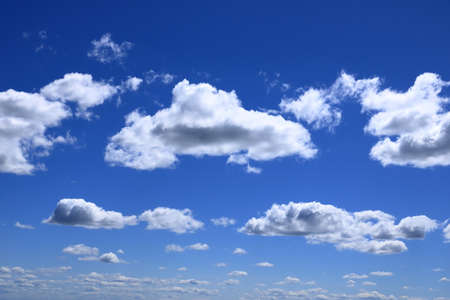 A blue sky background with white clouds
