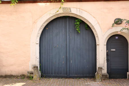 a large wooden door in an old country house