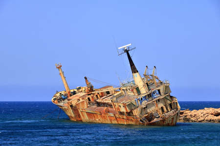 Shipwreck of the abandoned ship Edro III on the rocky coast at Akrotiri Beach in Cyprus