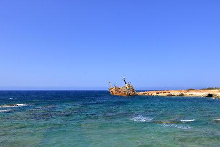 Shipwreck of the abandoned ship Edro III on the rocky coast at Akrotiri Beach in Cyprus