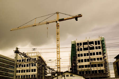 crane on building site next to train track
