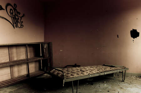 a left bed in a vandalised building
