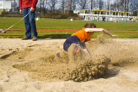 long jump with a lot of sand