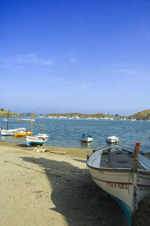 fishing boats lying on the beach of a bay photo