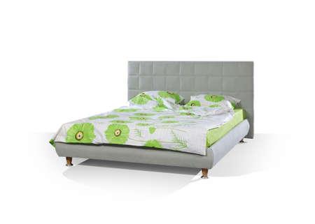 grey bed on white floor photo