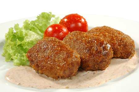 cutlets, sauce, tomatos and salad photo