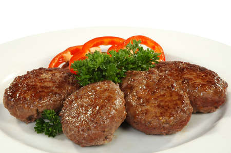 four cutlets with sweet pepper Stock Photo