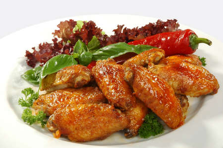 fried chicken wings in friture with red pepper