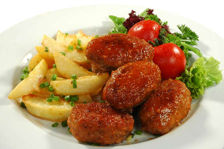 dish from fried potatos and cutlets