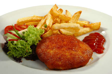 friture potatos, cutlet, tomamo, cucumber, salad and sauce on white plate