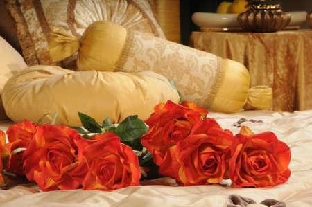 inwardly: red roses on a bed