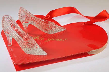 cinderella shoes: crystal fancy shoes for cinderella on a souvenir package in form red heart
