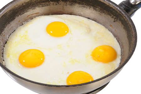 fried eggs from four eggs in a frying pan photo
