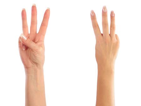 3 persons only: Female hands counting number 3 Stock Photo